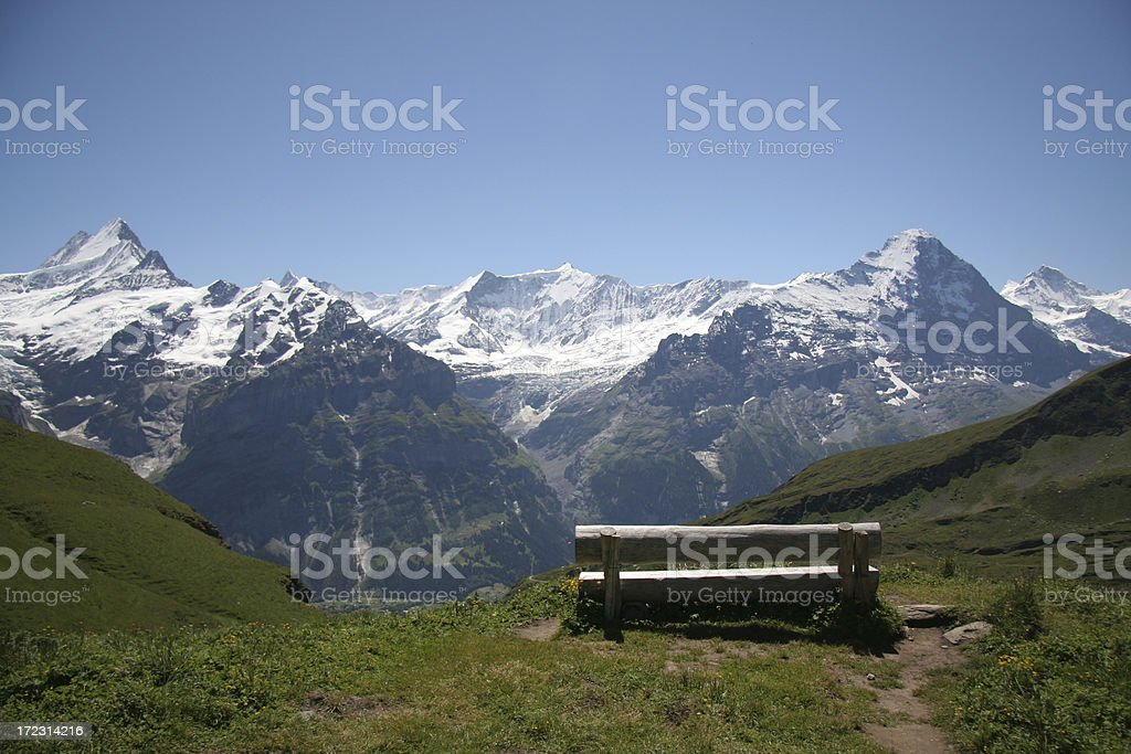Bench with Eiger and Schreckhorn view stock photo
