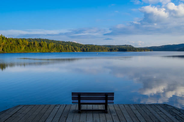 Bench with lake view on La Mauricie National Park (Quebec)