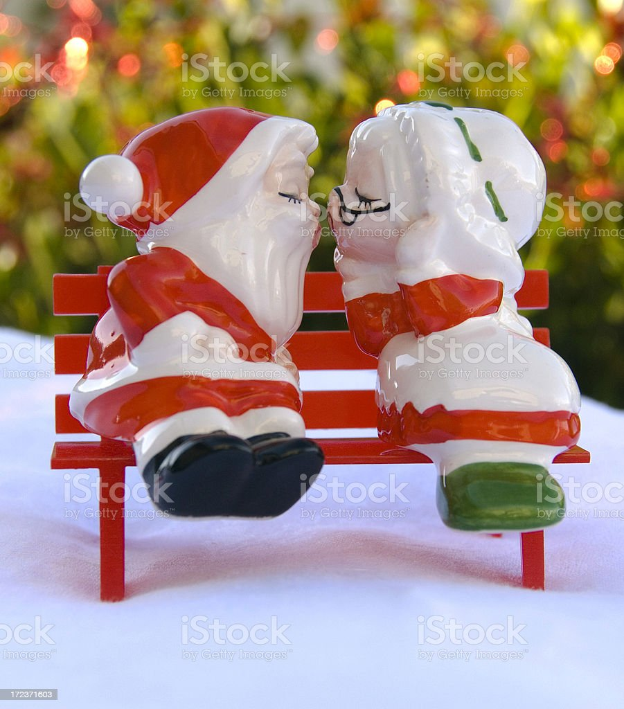 Bench with Mr & Mrs Santa Salt and Pepper Shakers royalty-free stock photo