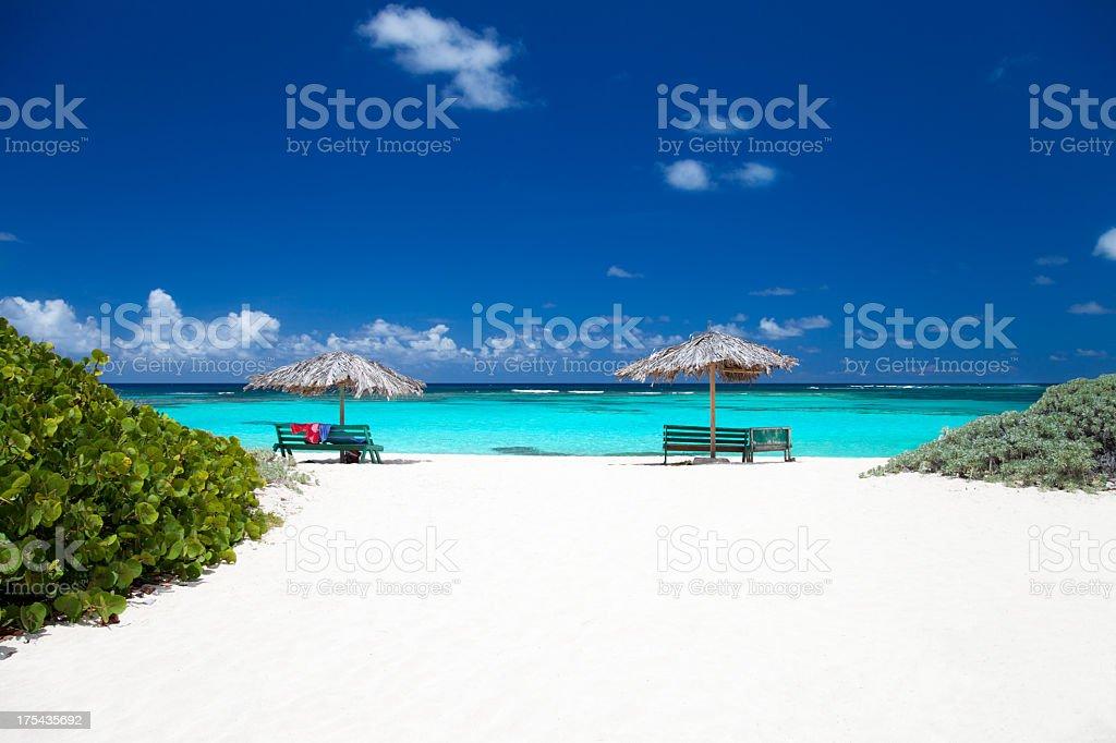 benches and umbrellas on a tropical beach in Anegada, BVI stock photo