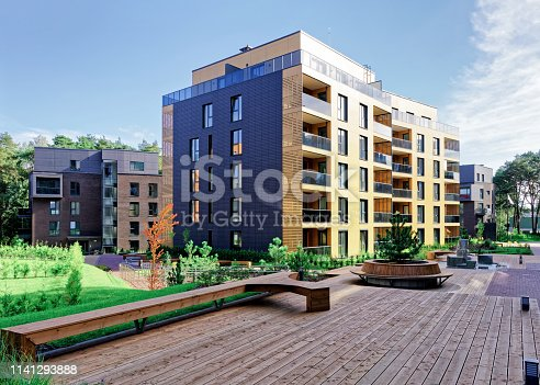 1165384568 istock photo Benches at Modern complex of apartment residential buildings 1141293888