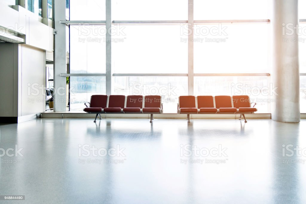 Benches at the airport waiting area stock photo
