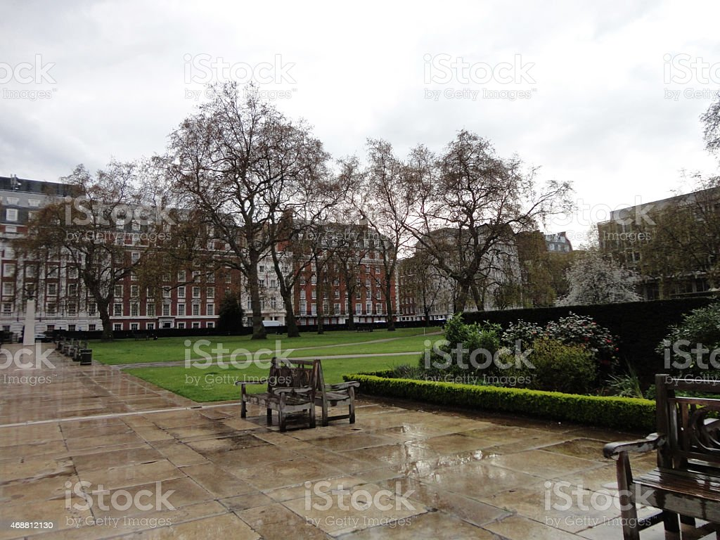Benches in Grosvenor Square After the Rain stock photo