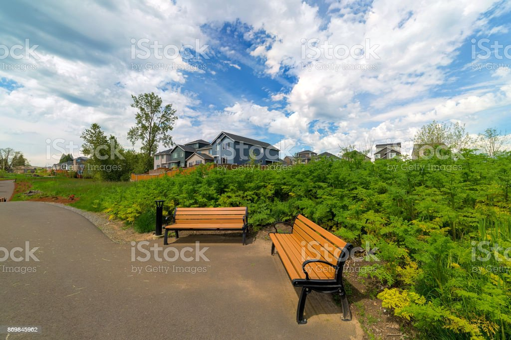 Benches in park along hiking trail in Happy Valley Oregon residential neighborhood stock photo