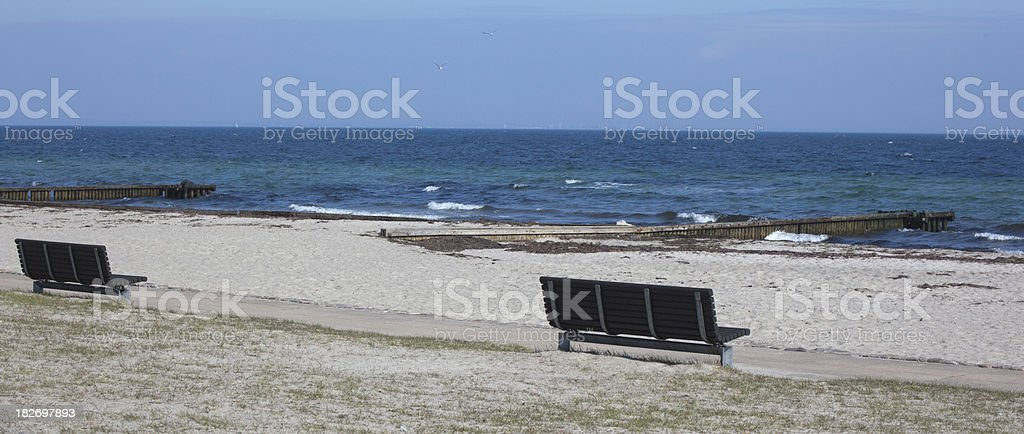 Benches on the beach stock photo