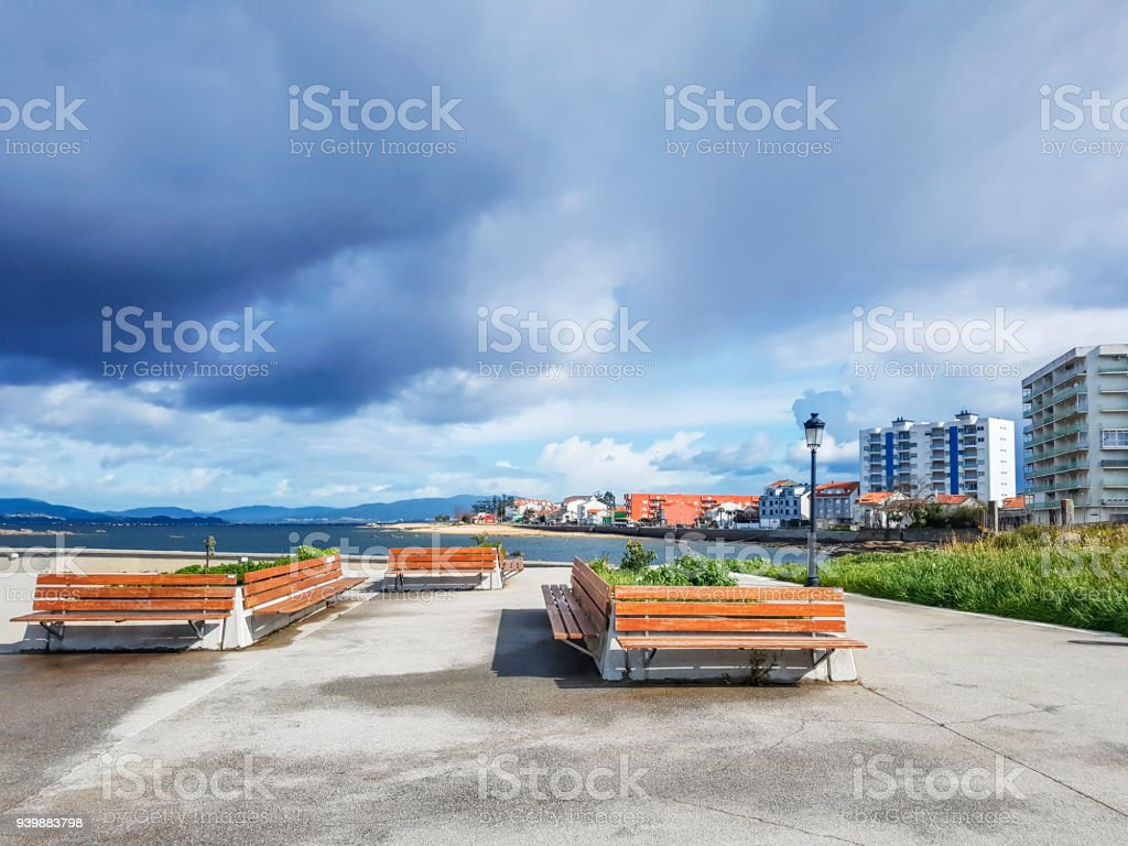 Benches on Vilanova de Arousa boardwalk stock photo