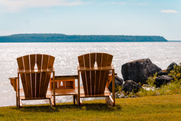 benches with a view of mackinac island on lake michigan - mackinac island stock photos and pictures