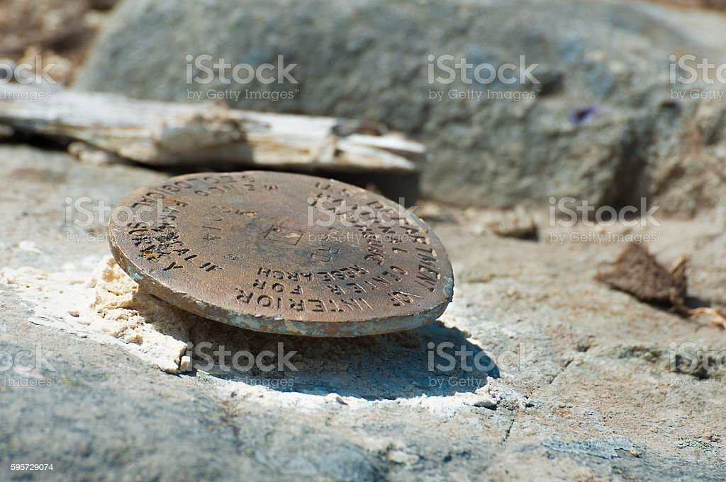 Benchmark For Earthquake Studies On Top Castle Peak Stock Photo
