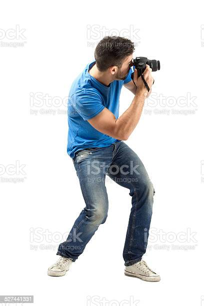 Bend young man taking photo with digital camera side view picture id527441331?b=1&k=6&m=527441331&s=612x612&h=qyjsb5nd3x4tw7 jab2sj8ipo39vjg uk2e4 c4zbei=