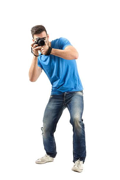 Bend young man taking photo with dslr looking at camera picture id527441325?b=1&k=6&m=527441325&s=612x612&w=0&h=kof3cmszy6w1koybumefgdnfzaz4bhijkvpyjijywma=
