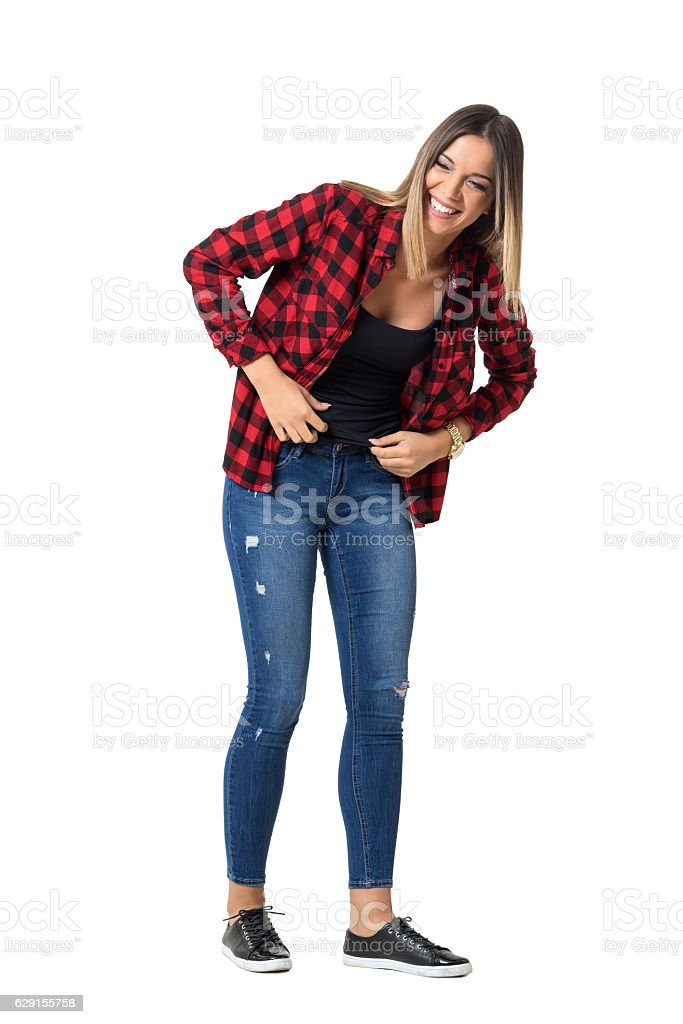 Bend young pretty woman in casual clothes laughing loudly stock photo