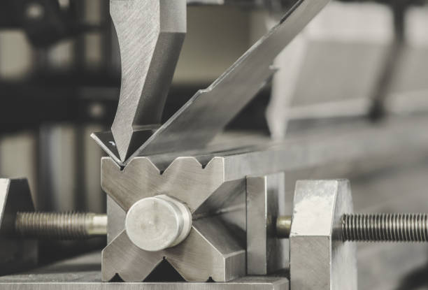 bending metal on a sheet bending machine, at the factory bending metal on a sheet bending machine, at the factory bending stock pictures, royalty-free photos & images