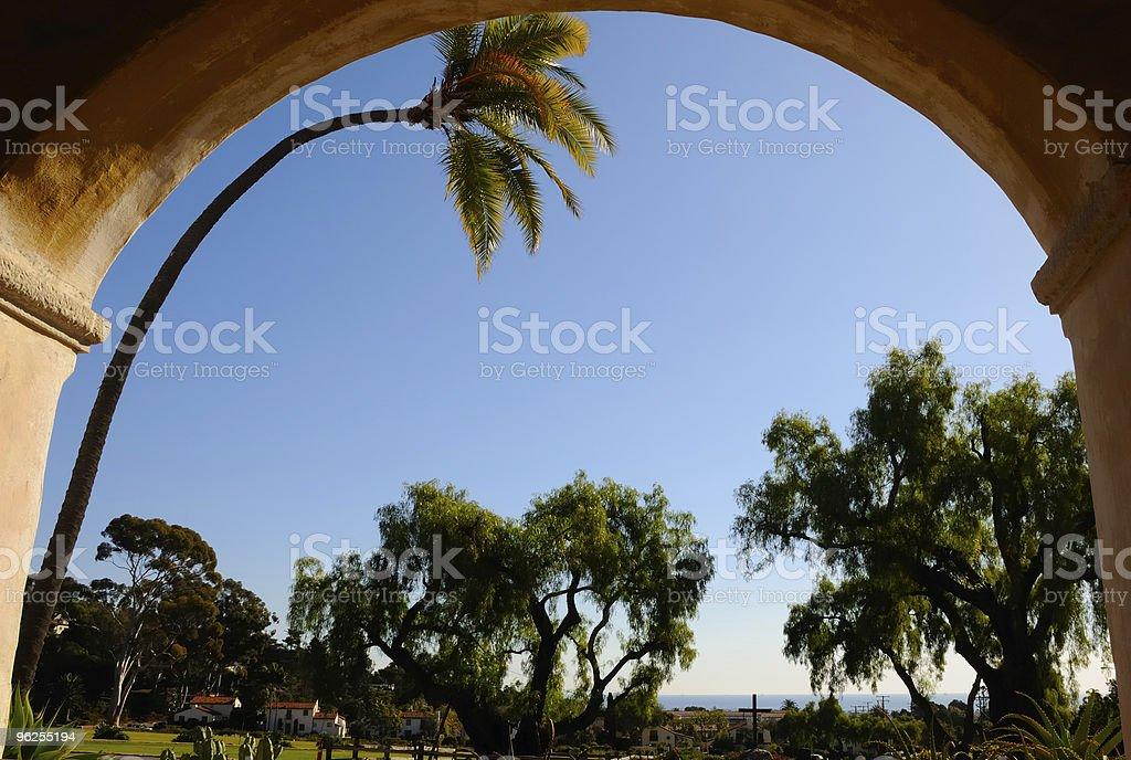 Bending Palm in Arch at Santa Barbara Mission - Royalty-free Adobe - Material Stock Photo