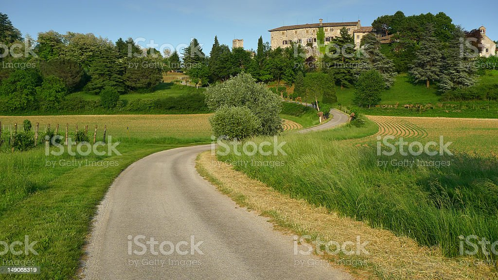 Bending road leading to a castle royalty-free stock photo