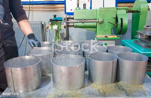 511814244istockphoto Bending worker sheet 933877476