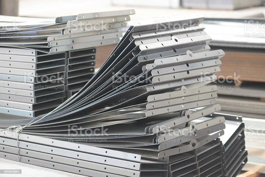 bending,Worker at manufacture, cidan folding machine,sheet metal work stock photo