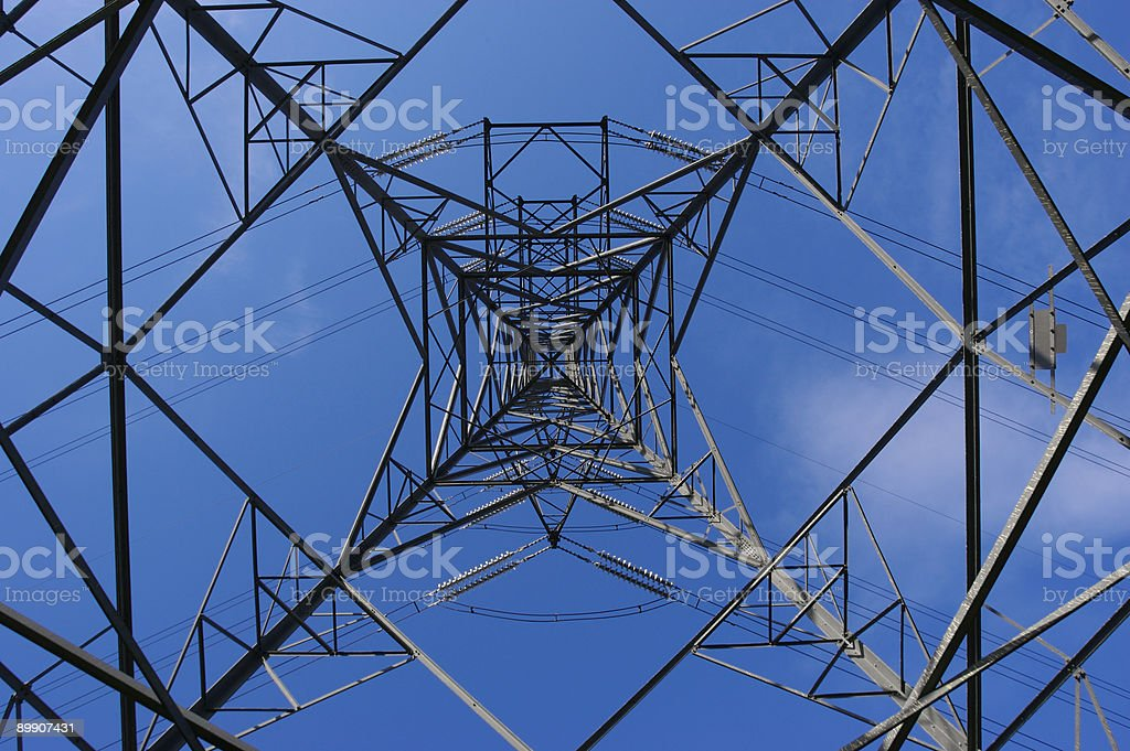 Beneath an electricity pylon royalty-free stock photo