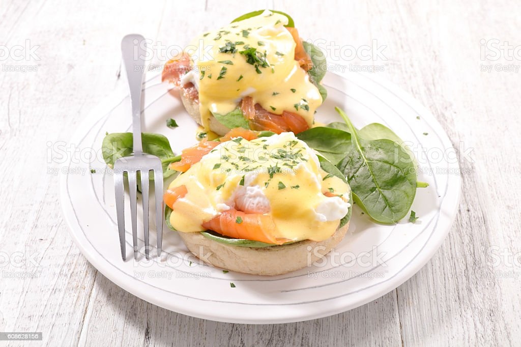 benedict egg with salmon and poached egg stock photo