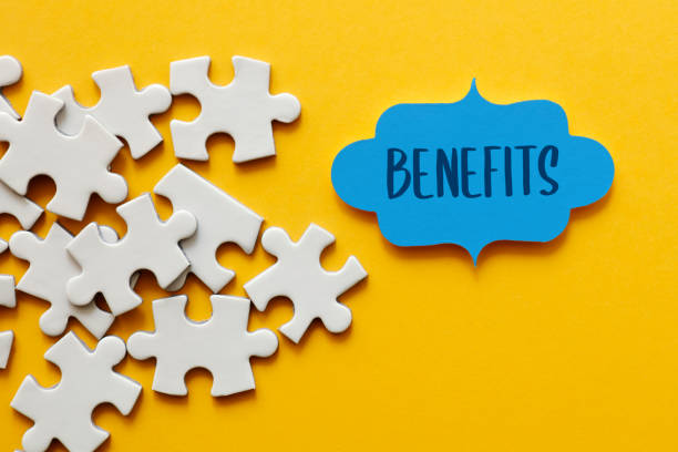 Benefits, Jigsaw puzzle concept stock photo