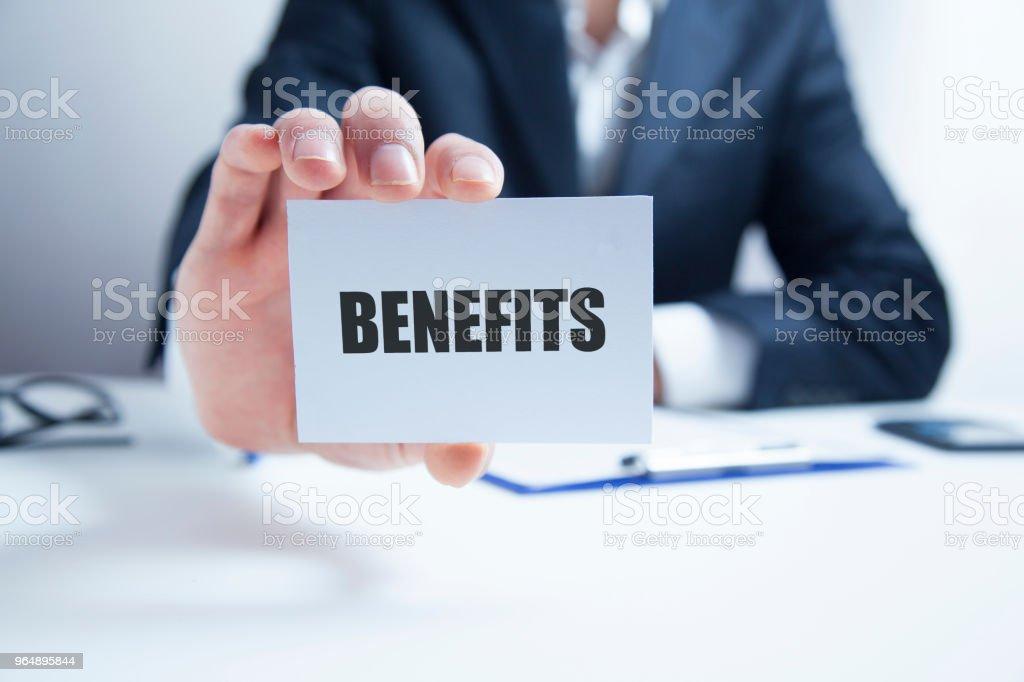 benefits texton card on man hand royalty-free stock photo