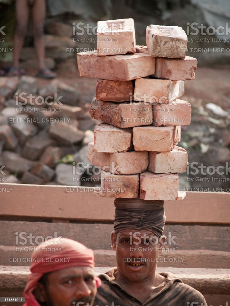 Bengali Man Carrying Bricks On His Head Stock Photo - Download Image