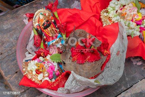 Kalighat, Kolkata, West Bengal, India - April 15th 2019 : God Ganesh and Goddess Kali on red seat are worshipped on auspicious day of Bengali new year. Traditional Bengali Hindu ritual.
