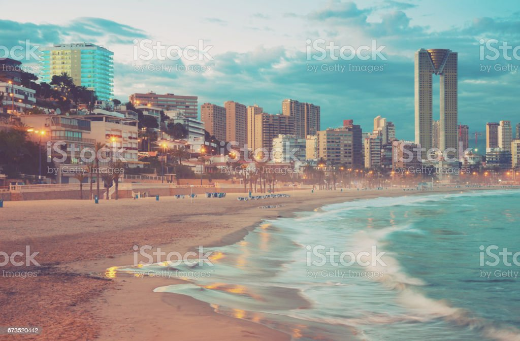 benidorm city evening stock photo