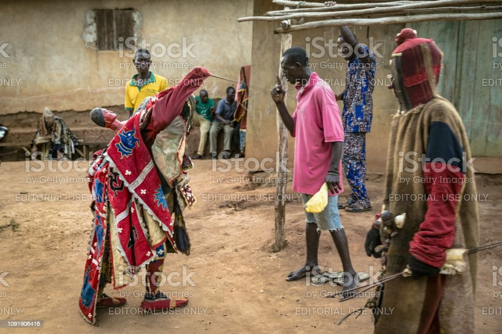 Benin West Africa An Egoun Egoun Spirit Chasing The Crowd