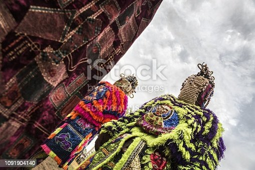 istock Benin, West Africa, Egoun Egoun spirits dressed in masks decorated with shells covering the face and continuing along the body with particularly festive drapes. 1091904140