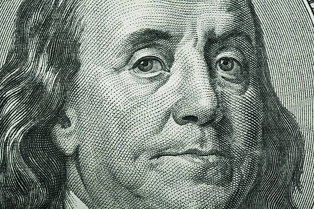 Benjamin Franklin Close-Up Macro photo of One Hundred Dollar Bill. Nice detail and tonal quality. benjamin franklin stock pictures, royalty-free photos & images