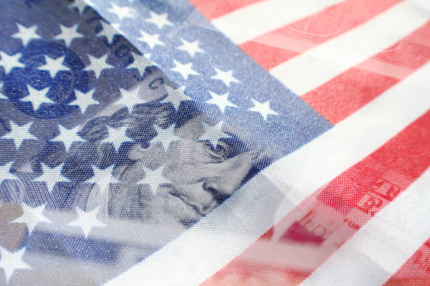 Benjamin Franklin On A One Hundred Dollar Bill With American Flag High Quality Benjamin Franklin On A One Hundred Dollar Bill With American Flag debt ceiling stock pictures, royalty-free photos & images