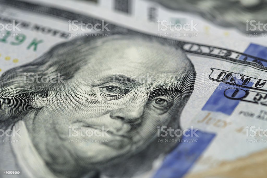 Benjamin Franklin on hundred dollar banknote, stock photo
