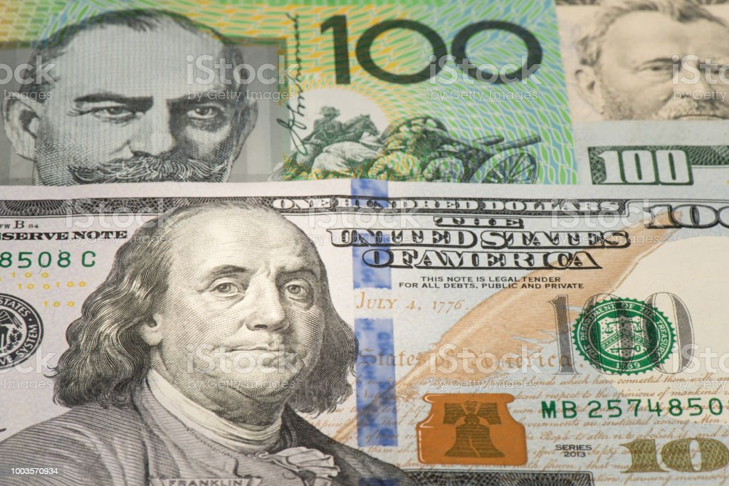 Benjamin Franklin on one hundred dollar banknote, Detail of banknote 100 USD and AUD with face stock photo