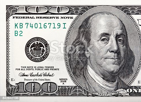 istock Benjamin Franklin on the bill. Macro shot of a 100 dollar 842642196