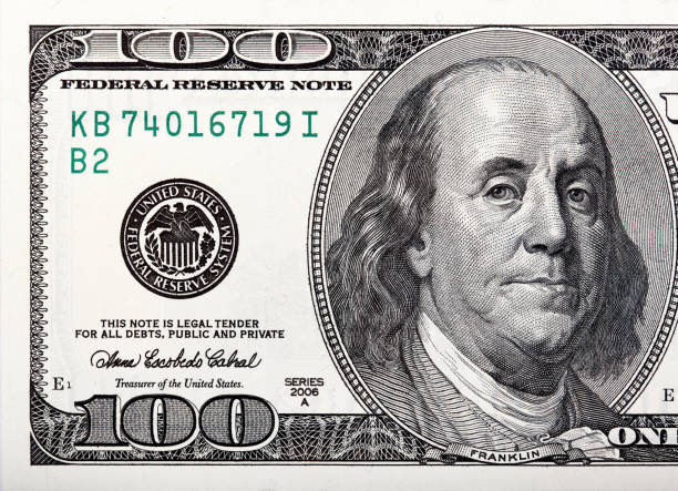 Benjamin Franklin on the bill. Macro shot of a 100 dollar Benjamin Franklin on the bill. Macro shot of a 100 dollar. High resolution photo. debt ceiling stock pictures, royalty-free photos & images