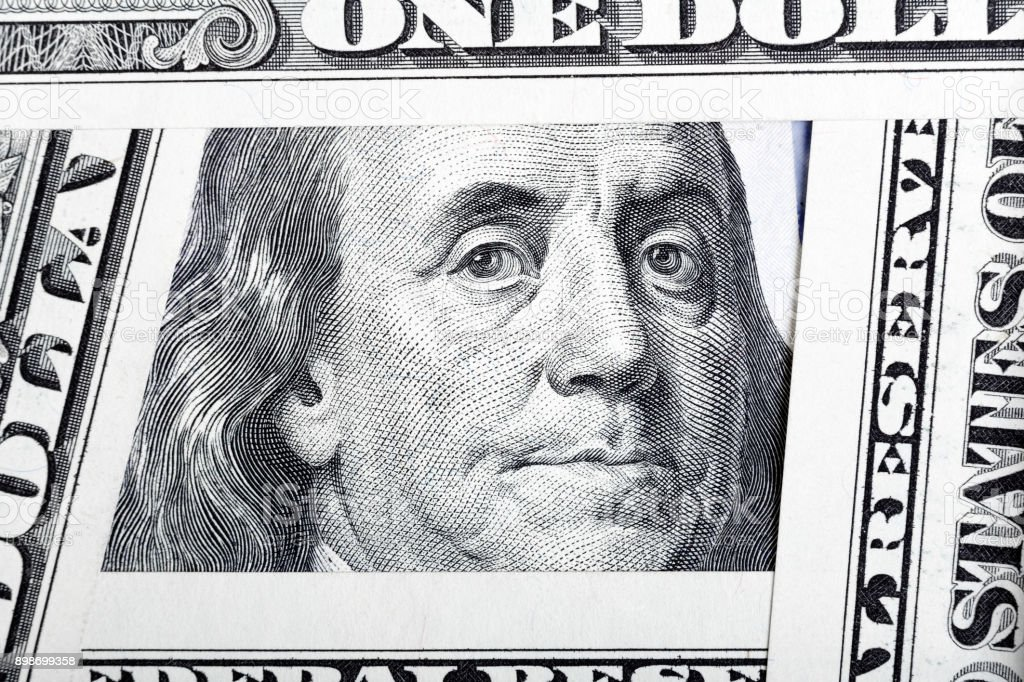 Benjamin Franklin on the one hundred dollar bill framed by other stock photo