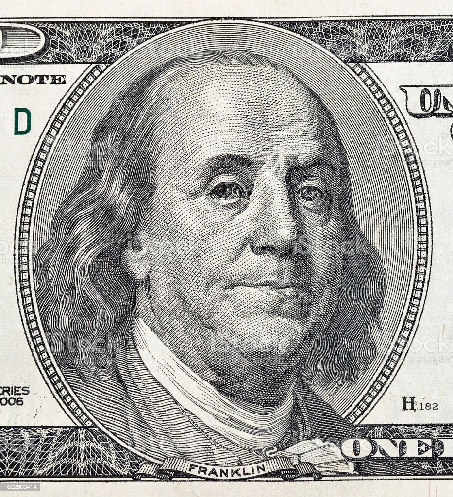 Benjamin Franklin portrait on one hundred dollar bill closeup stock photo