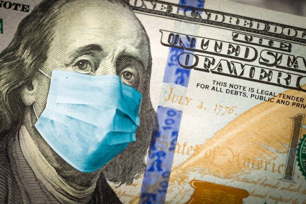 Benjamin Franklin With Worried and Concerned Expression Wearing Medical Face Mask On One Hundred Dollar Bill stock photo