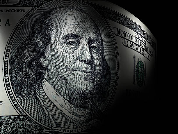 Benjamin Franklin's close up in a hundred dollar bill One hundred dollar bill with sharp focus and selective lights benjamin franklin stock pictures, royalty-free photos & images