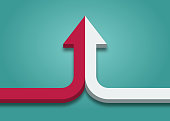 istock Bent arrow of two red and white ones merging on turquoise blue background. 1299472767