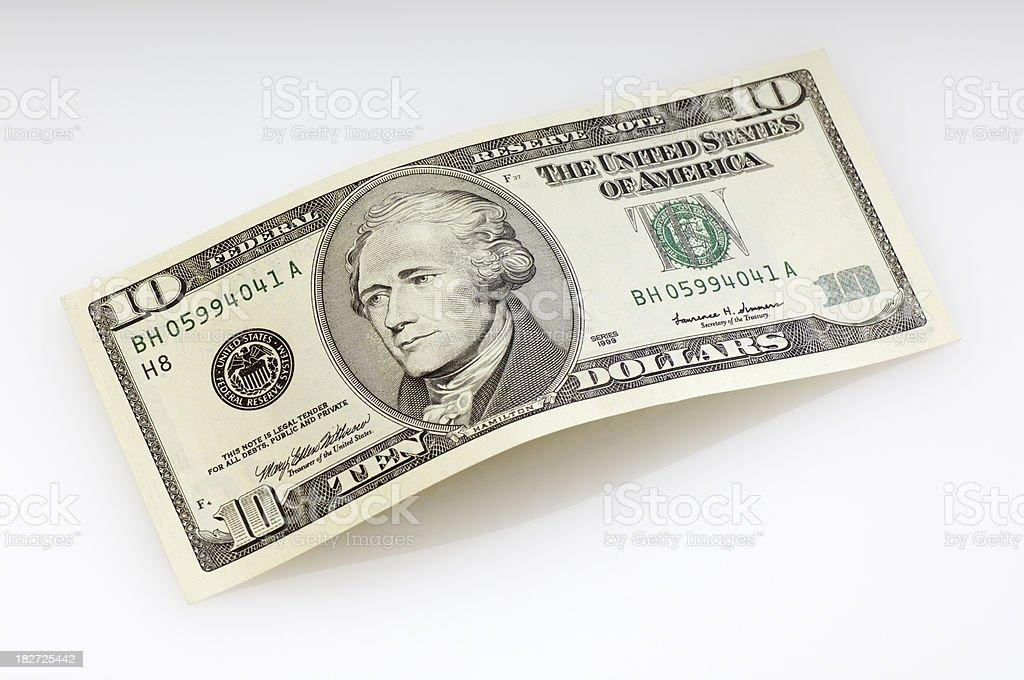 Bent ten dollar bill stock photo