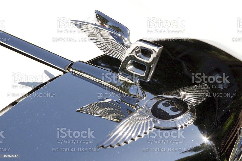 Bentley Badge and Hood Ornament in Sunlight Closeup stock photo