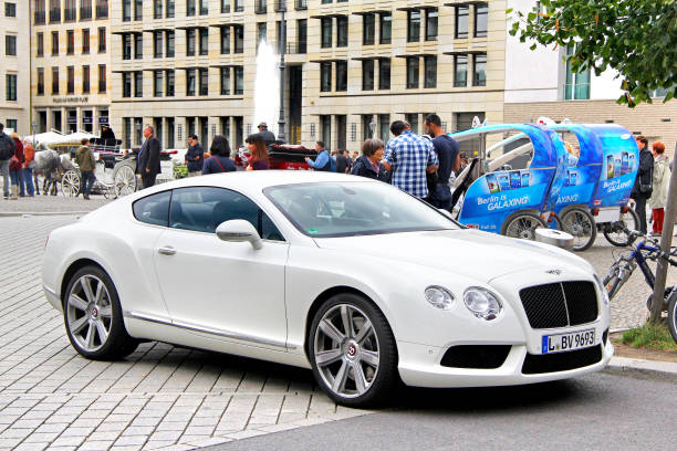 Bentley Continental GT Berlin, Germany - September 12, 2013: Motor car Bentley Continental GT in the city street. touring car stock pictures, royalty-free photos & images