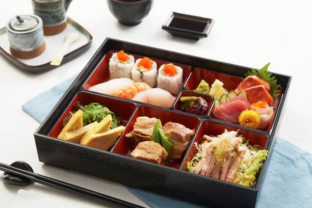 白い背景の上の弁当 - 日本食 ストックフォトと画像
