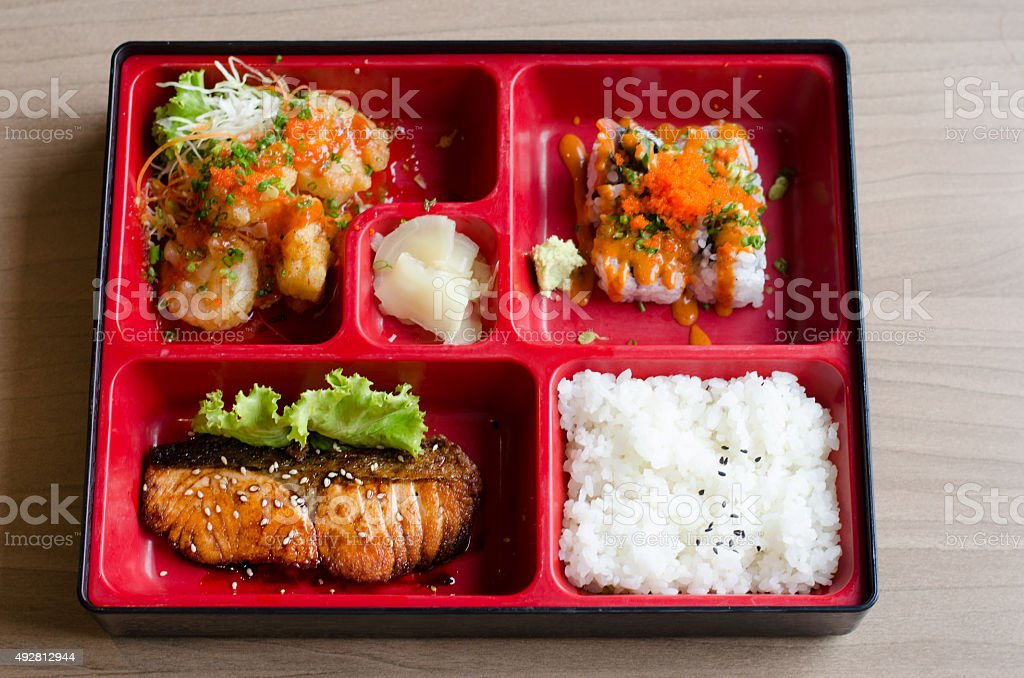 bento box with roll and salmon stock photo
