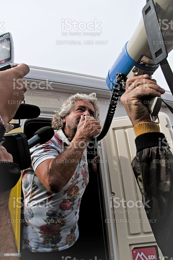 Beppe Grillo surrounded by reporters and photographers royalty-free stock photo