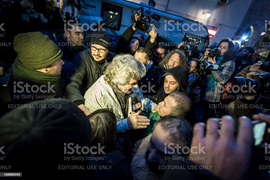 Beppe Grillo surrounded by reporters and photographers stock photo