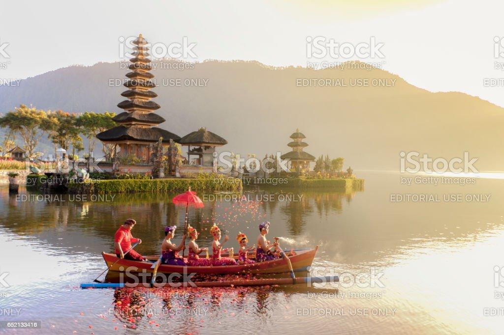 Beratan Lake in Bali Indonesia,  6 March 2017 : Balinese villagers participating in traditional religious Hindu procession in Ulun Danu temple Beratan Lake in Bali Indonesia stock photo