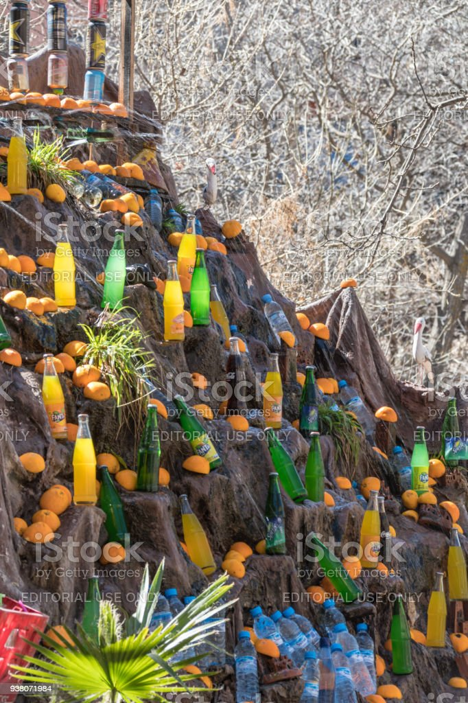 A Berber Fridge - using a snow melt waterfall to chill bottled drinks stock photo