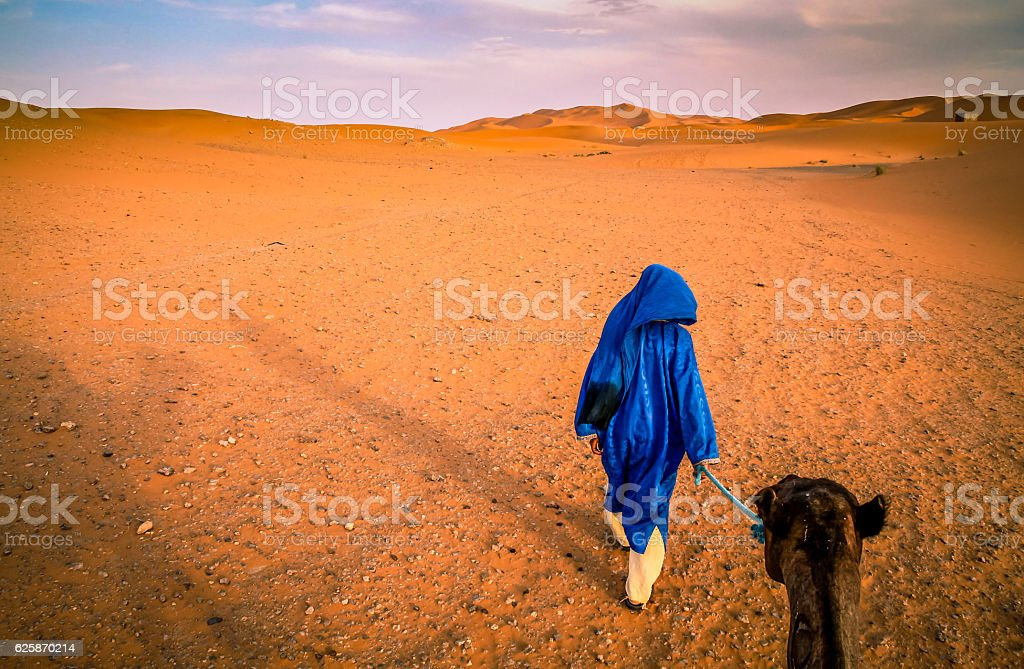 Berber guide on Merzouga sand dunes stock photo